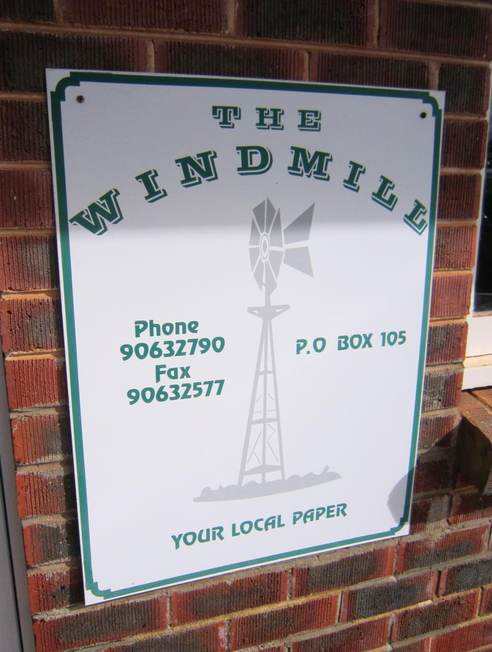Windmill Newspaper Sign